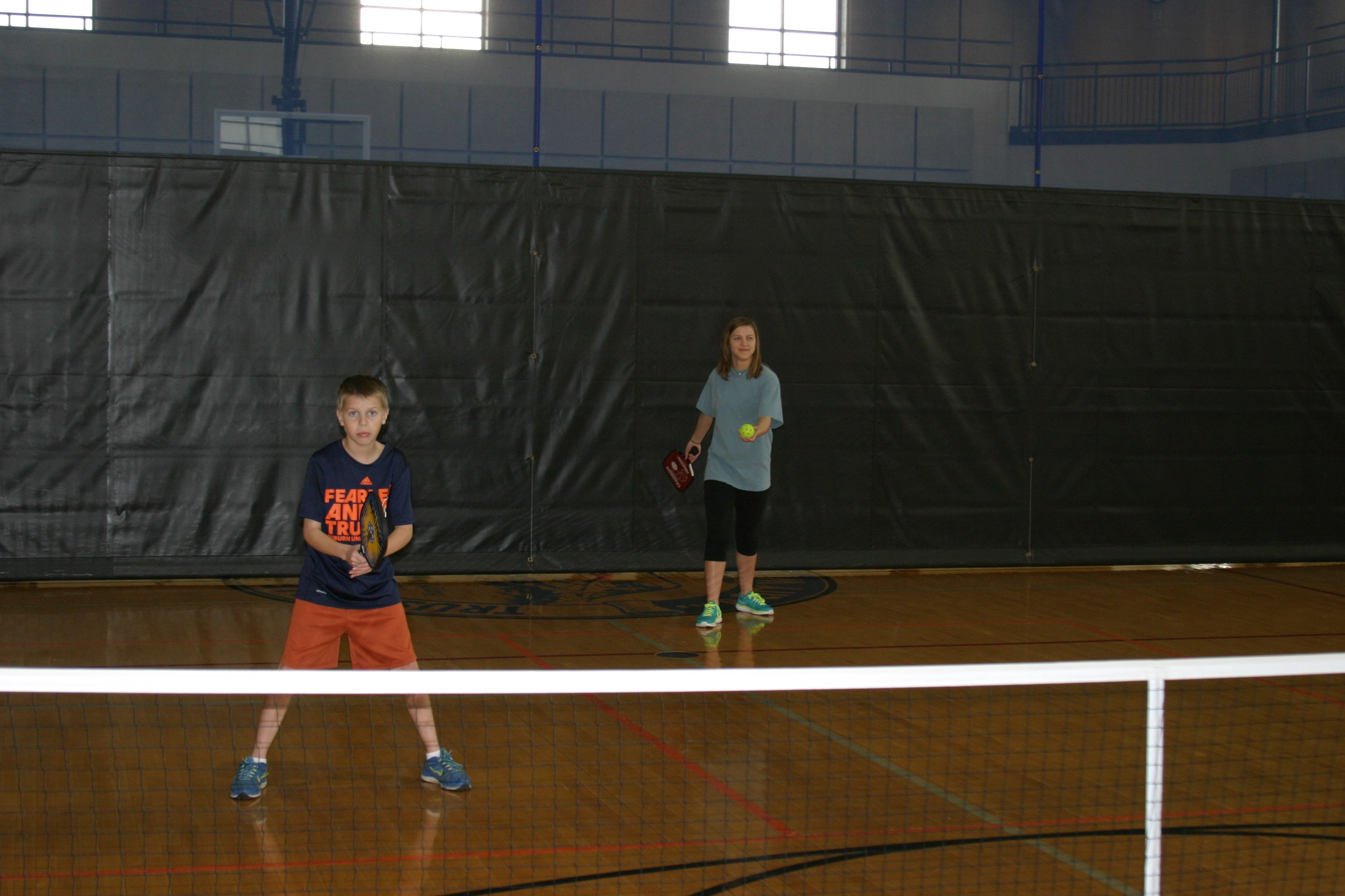 brother and sister playing pickleball in trussville alabama, alabama pickleball, trussville pickleball, birmingham pickleball